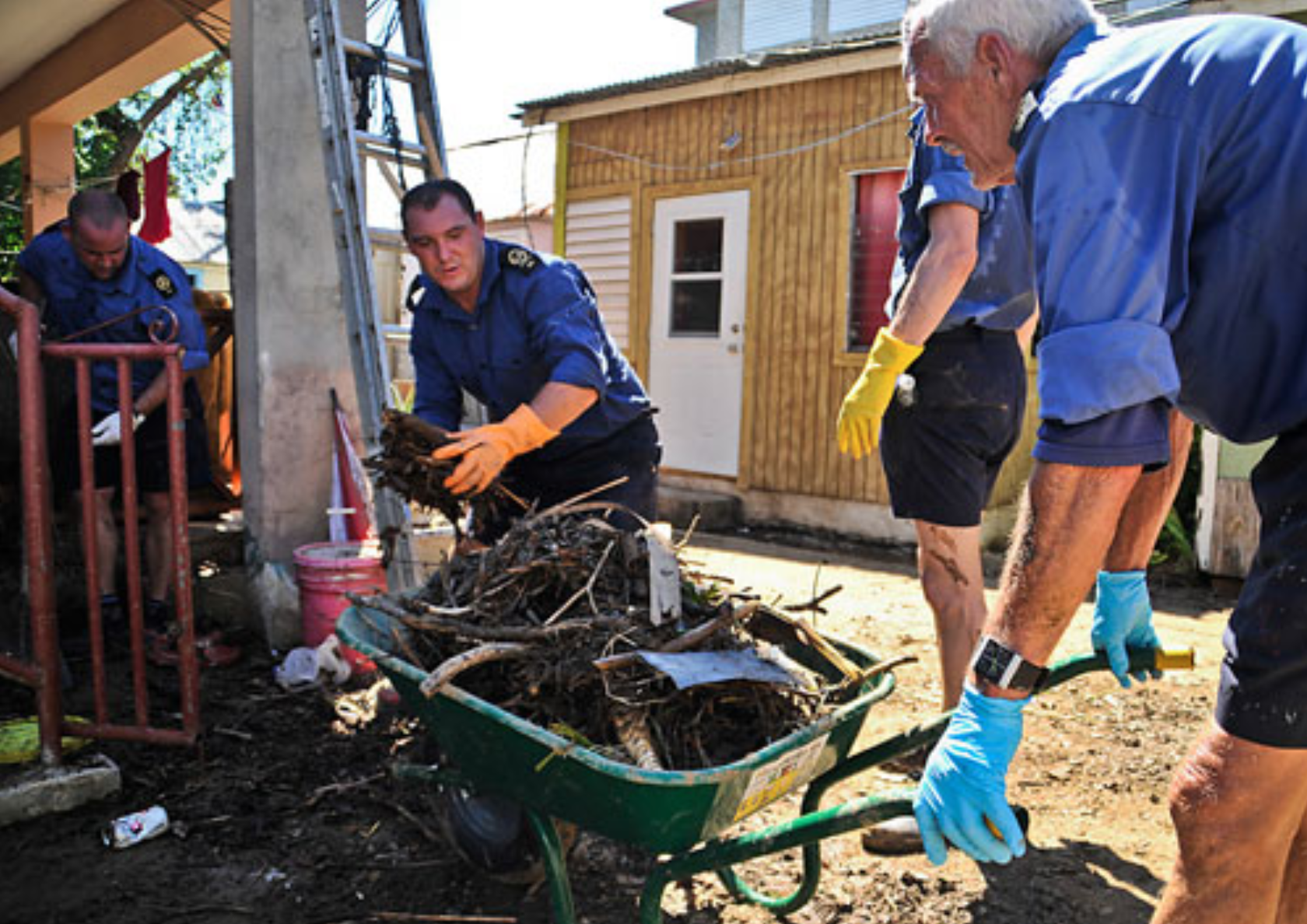 Crew of RFA Wave Ruler helping to clear flood debris, Tortola, British Virgin Islands Credit: Government of British Virgin Islands